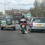 Motorcycle lane splitting photo.